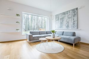 Two hairpin tables placed on round rug in white sitting room int